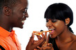 Beautiful african couple eating pizza