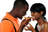 Young couple sharing a slice of pizza poster