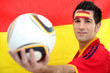 Male Spanish soccer supporter holding ball