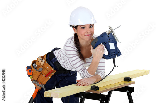 female woodworker smiling