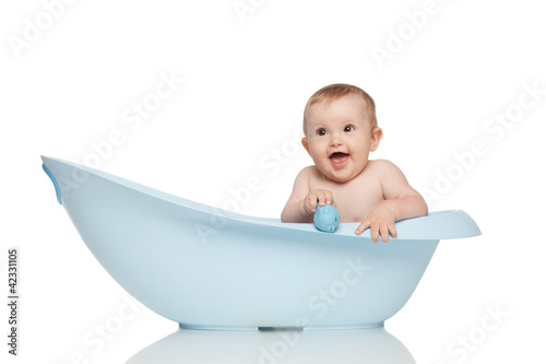 Girl in blue bath tub on white background