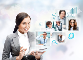 Portrait of businesswoman holding her tablet computer and commun