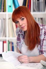 Redhead girl studying