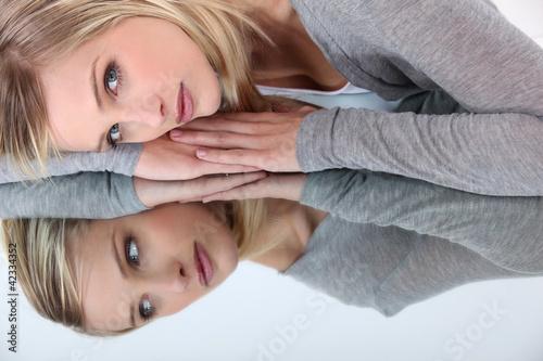 Woman reflecting in mirror