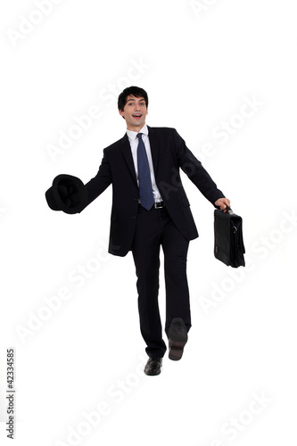 Man in a suit with briefcase and hat
