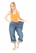 weight loss - proud of herself young woman in too great trousers
