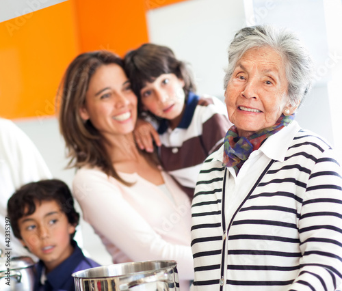Grandmother cooking for the family