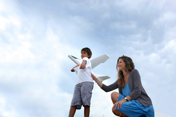 Mother and son playing with plane
