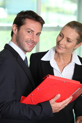 Businesswoman smiling at businessman