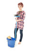 woman with blue bucket cleaning floor, full length
