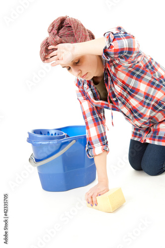 woman in casual shirt cleaning floor