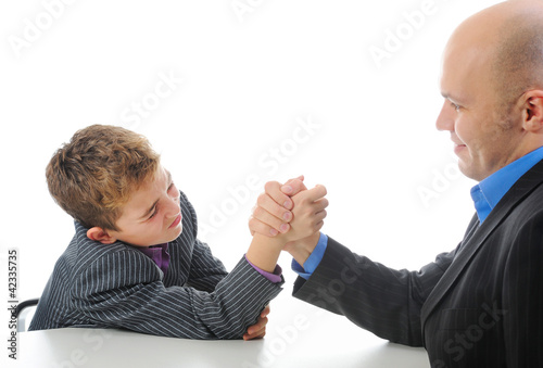 boy and a man arm wrestling