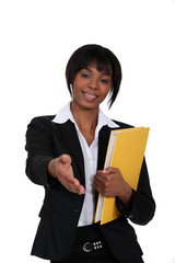 black businesswoman holding filer