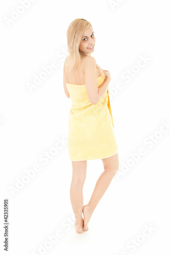 happy young woman in yellow towel, full length