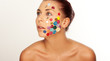 Woman with buttons on her face