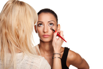 Makeup artist applying makeup to her model