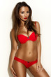 Exotic dark skinned model in red lingerie