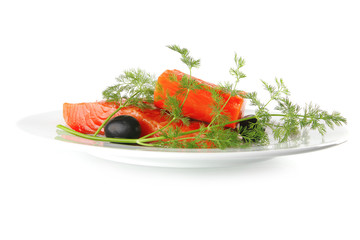 pink smoked salmon on white plate with olives