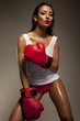 Seductive woman boxer glistening with sweat