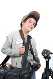 portrait of a kid dressed as a photographer