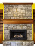 Gas Insert Fireplace with accent walls and shelves
