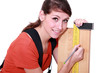 Woman marking plank of wood using set-square