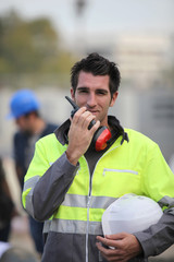 Construction worker with a walkie talkie