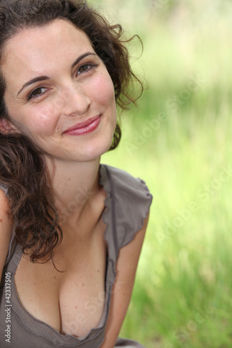 Brunette sat in field