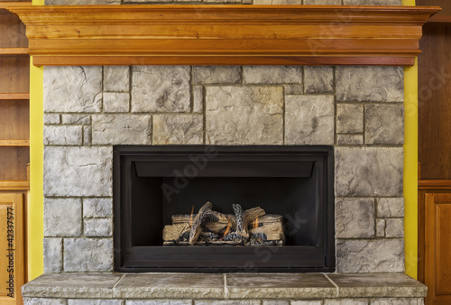 Natural Gas Insert Fireplace with Stone and Wood