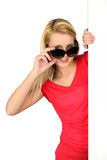 Woman peering over oversized sunglasses
