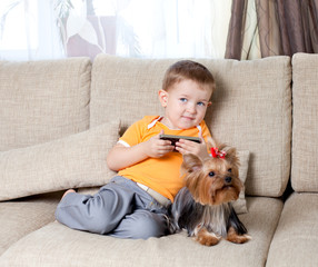 little boy  with loving dog york