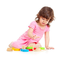 cute kid girl playing with colorful toys, isolated over white