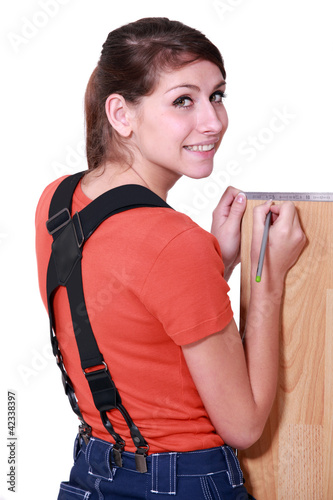 Woman measuring laminate flooring
