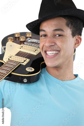 mixed race teenager with electric guitar