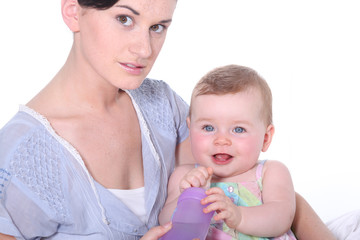 young woman holding her baby