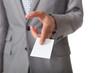 Confident businessman handing out card