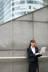 businesswoman outdoors with notebook