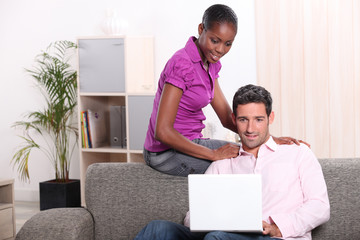 Couple in living room with computer