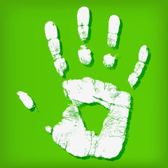Abstract hand print on a green background