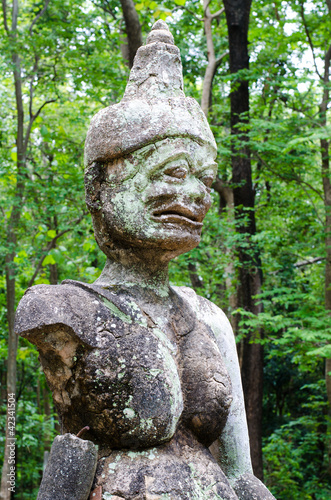 Ancient demon or Daityas  statue in Wat Umong at  Thailand.