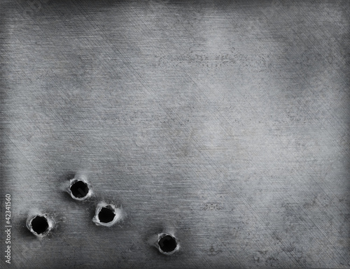 metal background with bullet holes