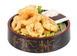 Deep batter fried squid rings calamari with green salad