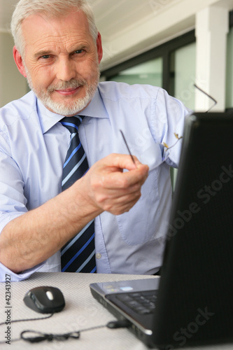 Man pointing to his laptop