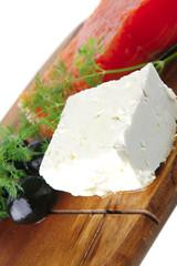 fresh smoked salmon on white plate with white cheese