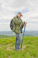 Senior birdwatcher trekking in mountains (Bieszczady, Poland)