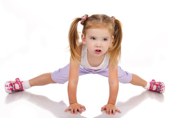 Gymnast cute little girl isolated