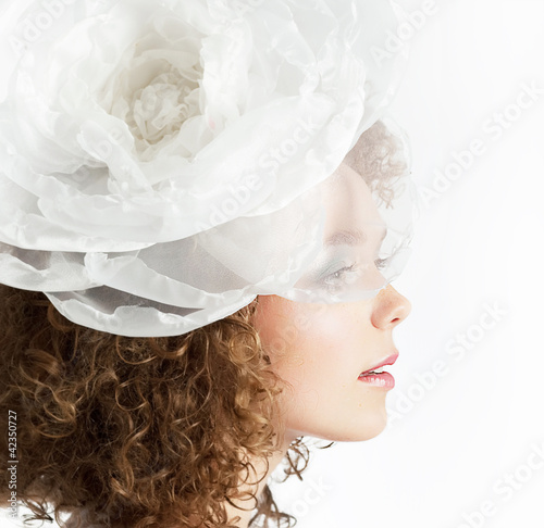 Beautiful curly red hair bride on white background close up