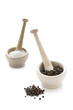 salt and pepper in pestle and mortars