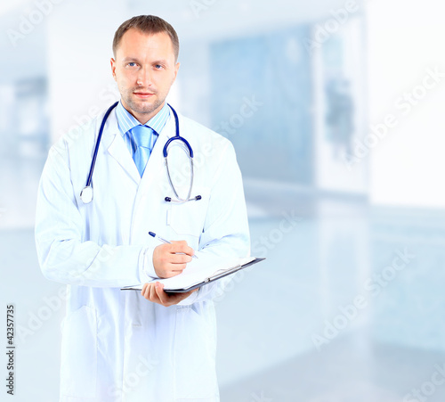 portrait of doctor with stethoscope with arms crossed