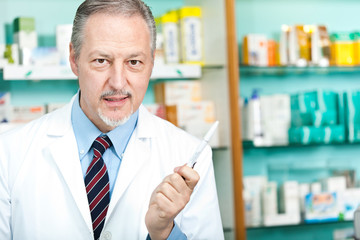 Pharmacist in his shop